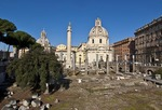 Trajan's Column in ruins of Trajan's Forum with Church of Santa Maria di Loreto, at left, and Church of the Santissimo Nome di Maria, at right, located north of Roman Forum in Rome