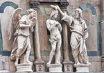 Florence's Baptistry of Saint John sculpture above Gates of Paradise, Baptism of Christ by Andrea Sansovino.