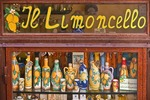 Window of shop specializing in Limoncello, locally made lemon liqueur, in village of Amalfi on Amalfi Coast