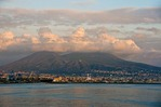 City of Naples at base of Mount Vesuvius, above in clouds, from Bay of Naples