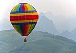 Hot air tourist balloon flight over karst peaks near Yangshuo in Guangxi