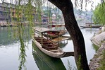 Fenghuang Cheng (Old Phoenix Town) with boats on Tuojiang River in early morning, Hunan province