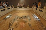 Lady Fu Hao Tomb artifacts and skeletons in Shang Dynasty royal family archaeological site at ancient Bronze Age capital of Yin in present day Anyang, Henan