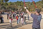 Parc Guell bubble maker with children chasing bubbles in Barcelona