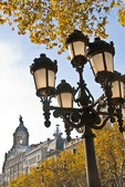 Barcelona's Paseo de Gracia, with autumn leaves, lamp post and architecture