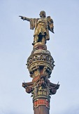 Barcelona's bronze statue of Christopher Columbus (Cristobal Colon) by Rafael Atche atop Corinthian column monument on La Rambla at the harbor