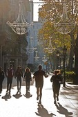 Barcelona's Paseo de Gracia with Sunday joggers and strollers in autumn