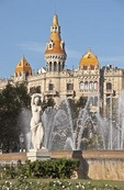 Barcelona's central Placa de Catalunya statue and fountain with Casa Rocamora in background
