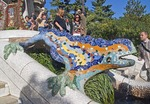 Antoni Gaudi's mosaic dragon fountain at entrance of Parc Guell in Barcelona