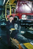 Beijing Jeep Corporation (AMC joint venture) auto worker on assembly line with Jeep Cherokee in 1987