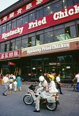 First Kentucky Fried Chicken fast food outlet in China on north side of Beijing's Tiananmen Square in 1988