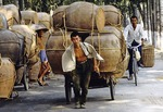 Hauling giant pots in the countryside near Qufu, Shandong province, in 1983