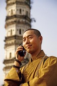 Buddhist monk on cell phone at Paintbrush Pagoda near Huangshan City, Anhui province, China, in 1997