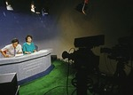1988 CCTV English Service news broadcast in Beijing by Xiao Ming, left, and Wei Hua, right (AKA Wang Weihua and WayHwa) who was fired in 1989 after political comments regarding Tiananmen demonstrations and became First Lady of Chinese Rock as vocalist for Overload and The Breathing