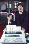 1987 portrait of Beijing Stone Computer Corporation engineers Wang Jizhi, left, and Wan Runnan, also company founder in 1984 and CEO, with English-Chinese word processor they innovated.  Wan, supporter of 1989 student demonstrations, escaped China in 1989 and lives in France.