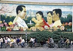 Family planning billboard in Chengdu in 1987 features a one-child family with popular former Premier Zhou Enlai