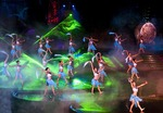 Outdoor stage show extravaganza featuring laser lighting and dancing young Tujia ethnic minority women at Zhangjiajie in western Hunan province