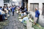 1985 peasant's free market in Suzhou.  Early 1980s agricultural reform in the countryside, free market socialism, was policy of Deng Xiaoping.