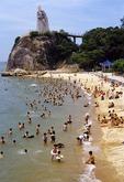 Beach on Xiamen's Gulangyu Island with statue of Ming dynasty hero/pirate Zheng Chenggong, who invaded Taiwan