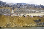 Embankments of the Yangtze River being reinforced in 2003 to prevent erosion when the Three Gorges Dam project will raise the water level up to 175 meters upon completion.  The plan to fill the new reservoir by late 2009 was delayed by drought, unforeseen landslides and ecological damage.