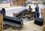 Soft coal compressed into briquettes being loaded for delivery to homes to be used for cooking and heating in Chengdu, Sichuan Province, in 1979.