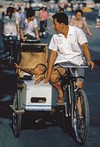 Father with son in home made bicycle side car on Beijing's Changan Avenue in 1982.  Such devices were later banned as unsafe.