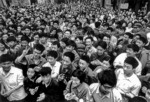 Large and curious crowd gathered in downtown Chongqing in 1979 to watch a visiting delegation of Americans returning to their tour bus.