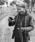 Peasant in 1981 seeing image for first time in Polaroid photo in countryside near Yangshuo (Guilin area of Guangxi)