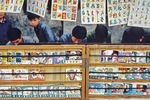 "Picture story books featuring a range of ""heroes"" for young readers at a public street library in Guilin in 1981."