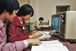 Nanjing middle school students in elective computer class using early Chinese made Panda brand computer with Hong Kong made keyboard in 1985.
