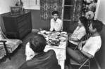 Family of a local artistic troupe official watching TV after dinner in their apartment in Xian, Shaanxi Province, in 1982.