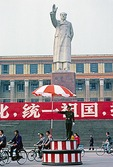 A Cultural Revolution era statue of Mao Zedong points the way politically forward in the Chengdu, Sichuan, city center in 1987 as China moved rightward.
