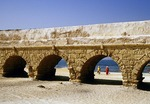 Ruin of Roman aquaduct along the beach at Caesarea on the Mediterranean coast of Israel