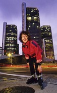 Advocate of urban commuting on roller blades, Mary Hebert, at downtown Detroit's Renaissance Center.