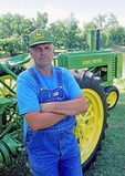 Farmer with 1939 John Deere Model A tractor
