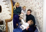 American family of four with dog in Midwest (Michigan)