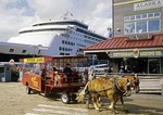 Ketchikan, Alaska, horse-drawn tour bus on cruise ship dock of city waterfront.