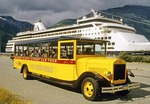 Skagway, Alaska, tour bus at cruise ship dock of city waterfront.