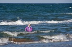 Arabic woman swimming fully clothed in Mediterranean Sea at Tunis, Tunisia