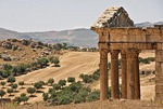 Capitol at Roman ruin of Dougga overlooking rugged countryside