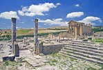 Forum of Roman ruin of Dougga with Capitol at rear right