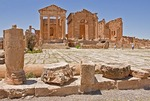 Grand forum of Roman ruin of Sufetula at Sbeitla with 3 Capitoline Temples to Jupiter, Minerva, and Juno