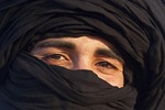 Eyes of young Tuareg man in Sahara sand dunes of Erg Chebbi near Merzouga, Morocco