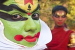 Kathakali performers in makeup before performance in Kerala, India.