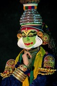 Traditional Kathakali performer with green make-up known as a pacha character, a mythological hero or protagonist, in the exotic dance-drama of Malabar.  The actor is an Italian studying in Kerala.