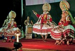 Traditional performance of Kathakali, one of the world's oldest theatrical dance-dramas, on stage with actors in elaborate costumes and musicians in Kerala, India.