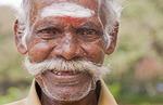 Elderly Hindu man tuk tuk driver on streets of Madurai