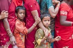 Boys with mothers in line of Hindu pilgrims at entrance to Sri Meenakshi Sundareswarar Temple in Madurai
