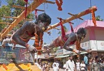 Tamil devotees suspended by fish hooks for Thaipusam Festival at Muruga or Murugan (Hindu god of war) Temple at Chathanoor, Kerala