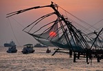 Cantilevered Chinese fishing nets at sunset at Cochin (Kochi) on Malabar coast of Arabian Sea in Kerala